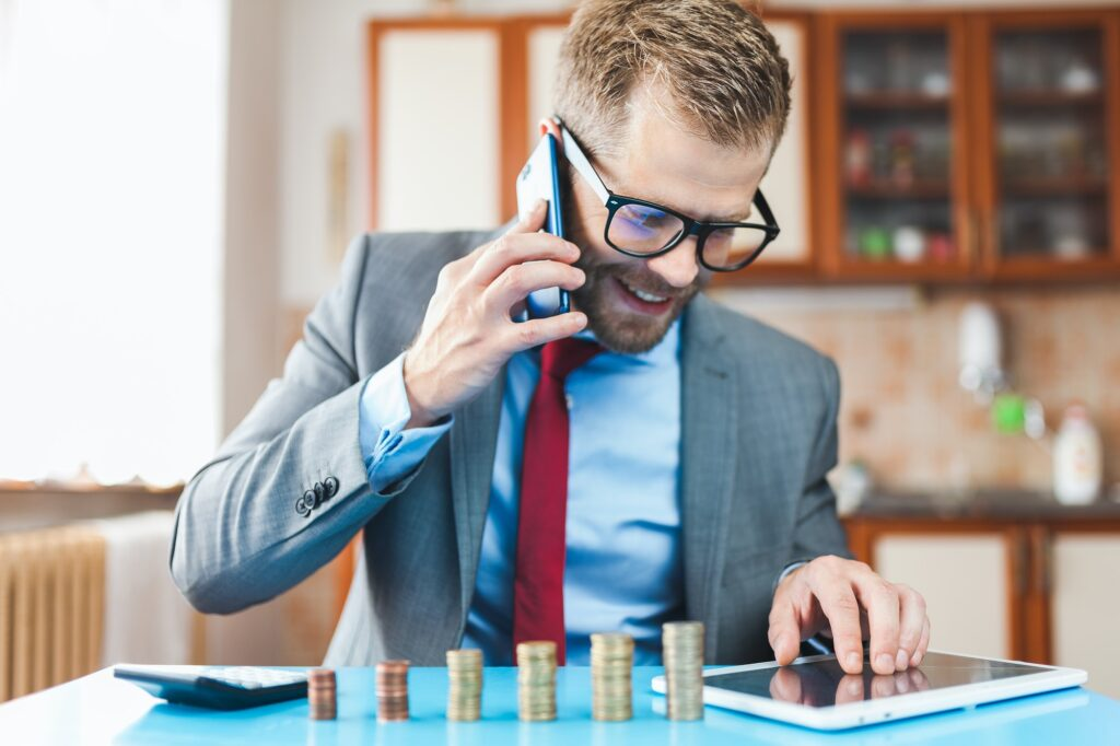Working from home. Businessman checking on returns from his investment